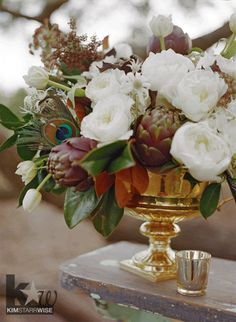 This arrangement sits on a mantel outside at Stella Plantation. It includes tulips, David Austin garden roses, hydrangea, artichokes, magnolia, ranunculus, flannel flower, and chocolate lace.