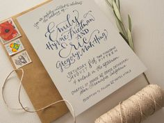 """This """"midnight in San Francisco"""" invitation suite was so fun and eclectic! We love the vintage ferry building postcard, deep indigos, California-themed vintage stamps and subtle nods to the city's """"summer of love""""."""