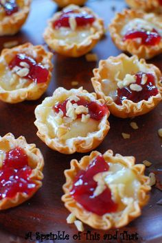A Sprinkle of This and That: Raspberry Brie Tartlets . I think I'll try strawberry instead of raspberry .