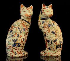 Pair of Japanese Imari porcelain cat figures.
