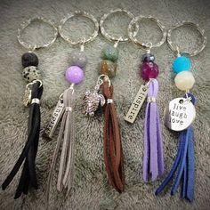 Recycle the semi-precious stones from old jewelry to make cool DIY keychains. Knot leather strips together with wire, add beads and inscribe your message in a metal plate.