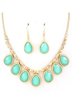 Faceted Turquoise Mint Teardrops with a light touch of Shimmer, suspended from Golden Diamond Faceted Pebbles.