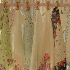 Another way to display my vintage hankies... now I am going to have to keep my eyes open for vintage curtain clips. Sheesh! =)