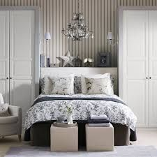 Not too interested in the wallpaper and bedding but I like the two wardrobes on either side of this bed. Definite possibility, Ikea time.