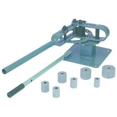 """Bench Top Bar and Rod Bender (Round)   Create standard or unique parts with this professional quality bench top bar bender. The heavy duty unit includes 1"""", 1-1/4"""", 1-1/2"""", 1-3/4"""", 2"""", 2-1/2"""" and 3"""" round dies and a right angle die to accommodate a wide range of jobs. The bar bender handles 5/8"""" round or square solid rods and 3/16"""" x 1-1/4"""" or 1/4"""" x 2"""" mild steel sizes.  Capacity: 3/16'' x 1-1/4'' or 1/4'' x 2'' mild steel size  5/8'' round or square solid rod  Handle telescopes to 44''"""