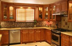 oak kitchen cabinets with glass doors