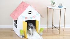 Transform that stack of old boxes into a chic cat house that you can humble brag about on Instagram.