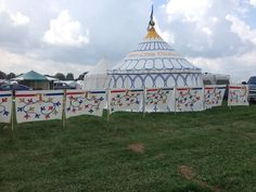Astrida & Stephens Glampy Pennsic camp. Her hand painted panels are pretty amazing, as is their pavilion.