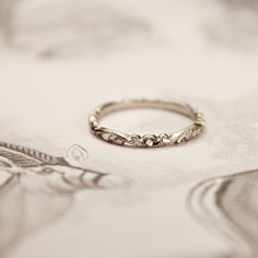This is a pretty photo of a delicate vintage (engagement) ring.