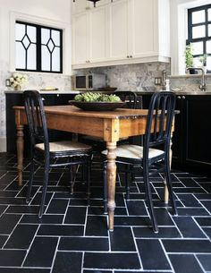 I will re-pin this every time...my absolute favorite kitchen. Love the white cabinets on top and black on bottom!