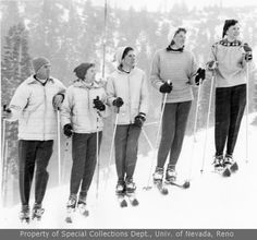 Unidentified skiers in a row looking uphill (1959)