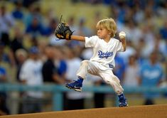 """Three-year-old Christian Haupt throws out the ceremonial first pitch prior to the Los Angeles Dodgers' baseball game against the San Diego Padres, on September 4, 2012, in Los Angeles, California. (AP Photo/Mark J. Terrill)""  (seen on theatlantic.com)"