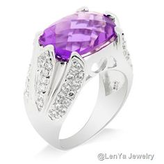 This magnificent ring has a large Amethyst main stone and comes with a beautiful complement of Swarovski Zirconia. This large ring is fit for making an appearance in social circles when you want to invite some envy from onlookers. Swarovski Zirconia is a popular brand of Cubic Zirconia which is renowned for their quality and precision. The band of the ring is coated with a layer of Rhodium which adds a glitter to the ring.