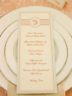 Menu Monograms--The architectural element was translated into a diamond-grid motif that bands the top of the menu on either side of the monogram