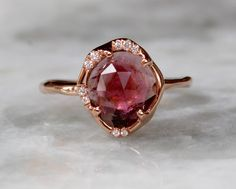 This handmade ring sparkles and shines from all directions.  A beautiful watermelon tourmaline center stone glows in all ambient lighting and really makes a statement. 2.22 carats tourmalin...