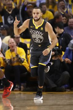 4674576e1774 Stephen Curry of the Golden State Warriors reacts after scoring against the Houston  Rockets during Game Four of the Western Conference Finals of the 2018 ...