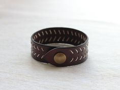 Hey, I found this really awesome Etsy listing at https://www.etsy.com/listing/229189943/brown-stitched-leather-cuff-bracelet