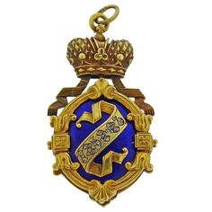 For Sale on 1stdibs - Antique 18k gold locket pendant by Faberge, set with blue blue enamel , pearls and rose cut diamonds. Pendant is 38mm x 20mm. Marked with Faberge hallmark,