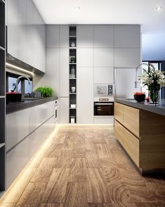 Modern and stylish kitchen design with clean white cabinets and a wooden kitchen island and dark counter top Grey Interior Design, Interior Design Kitchen, Contemporary Interior, Contemporary Stairs, Asian Interior, Contemporary Kitchens, Contemporary Chandelier, Contemporary Office, Interior Doors