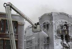 Burning warehouse In Chicago freezes while firefighters try to put the blaze out