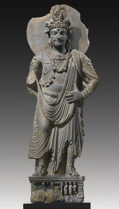 A GREY SCHIST STANDING BODHISATTVA Height: 57 3/4 in. (148 cm) Ancient region of Gandhara, Kushan period, 3rd/4th century