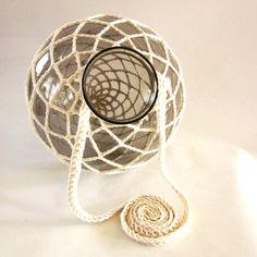 My latest x-tra large crocheted globe candle holder made from upclycled smoke colored glass.