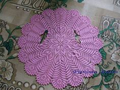 """I'm pretty sure this started out as a doily, but by using yarn and adding """"armholes"""" it's now a shawl!"""