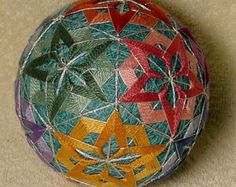 Temari means Handball. A Highly valued gift symbolizing deep friendship and loyalty. Brightly colored threads with the Recipient a Brilliant and Happy Life Temari is an ancient form of Japanese culture and art, the gift or a Temari ball is believed to bring good fortune to the recipient. This Temari ball is a Styrofoam ball wrapped with yarn , then thread and sewn with contemporary and traditional patterns. 3 1/4 inch diameter