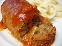 *Grandmothers Cabbage Rolls*1 cabbage,1 lb ground beef,1 med onions,1 c rice,salt,pepper,  1 can tomato soup,1 can water .Cook rice drain sit aside.Cook beef & onions,add salt & pepper.Boil cabbage leaves to soften. Mix rice & beef mixture,put in leaves & roll up.Mix soup & water ,pour over cabbage rolls & cook in electric skillet on low about 20 minutes. Cool & serve.