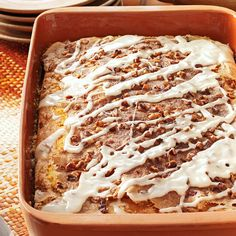 Coconut-Pecan Coffee Cake Recipe -I've learned to keep copies of the recipe on hand when I serve this moist and satisfying coffee cake. It has a nice level of coconut flavor from the pudding mix. —Beth Tropeano, Charlotte, North Carolina