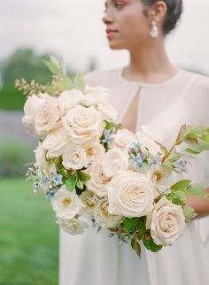 Wedding bouquet goals: lots of romantic white/cream roses, lush touches of greenery and pops of tiny, pale blue flowers for your 'something blue' pretty picture-perfect if you ask me! Modern Wedding Flowers, Bridal Flowers, Flower Bouquet Wedding, Floral Wedding, Flower Bouquets, Blue Flowers, Gold Wedding, Pastel Bouquet, Blush Bouquet