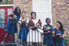 Bridesmaids wear navy blue satin dresses | Photography by http://www.babbphoto.com/