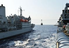 Fleet Flagship HMS Bulwark has restocked her food supplies during a marathon 14-hour replenishment with Royal Fleet Auxiliary Fort Austin in the middle of the Red Sea.