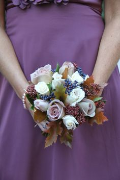 he Bridesmaid's Bouquets toned with their purple gowns so perfectly I included a collection of Roses in muted tones including Safi Blue, Mentha, Amnesia, Quicksand, Vendella and 4 Good Roses with Skimmia, Viburnum Tinus Berries and Autumn Leaves