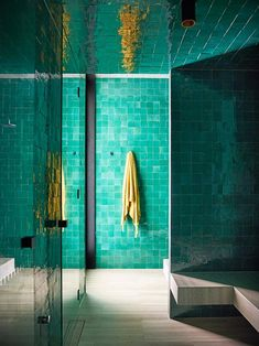 Green glazed Moroccan tiles in steam room. | Photo: Anson Smart | Story: Belle