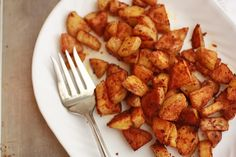 Parmesan Roasted Potatoes    Ingredients:  4 medium potatoes, skins on, scrubbed and diced*  2-3 Tbsp olive oil  1/2c grated parmesan  1 tsp garlic salt  1/2 tsp paprika  salt and pepper to taste