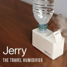 """Travel Humidifier - """"Just add your own water bottle, plug the unit in and enjoy clean, moist air. Fits most standard PET bottles (max 17 oz). Features an automatic shut off and emits no sound. Pet Bottle, Water Bottle, Travel Bottles, Humidifier, Natural Cures, Barware, Innovation, The Cure, Household"""