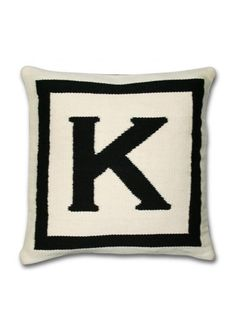Jonathan Adler's needlepoint alphabet pillows have become a home decor classic.