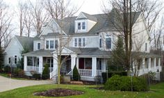 I LOVE HOUSES WITH WRAP AROUND PORCHES...