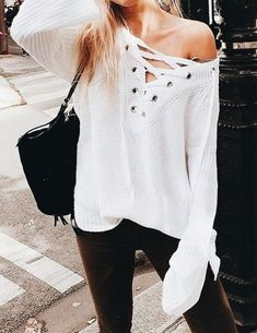 Cute off the shoulder top with dark chocolate pants.