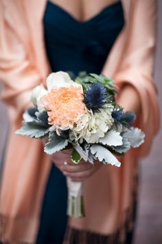 Romantic Winter Wedding: Flowers. Also love the peach shawl with the blue bridesmaid dress. Beautiful! Navy Blue / Blush / Champagne and White with hints of green. Perfect winter wedding.