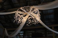 """hula hoop chandelier: white duct tape-2 strands drippy xmas lights-zip ties-1""""x1"""" wood reinforcements-eye hook-very tall ladder."""