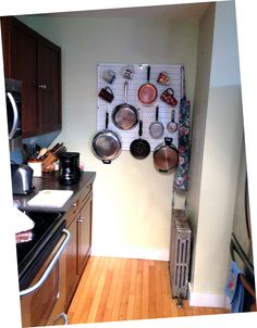 Cramped kitchen? No more cabinet space? No problem! Let Wall Control's Kitchen Pegboard free up some valuable storage space by organizing your bulky pots and pans on unused wall space where you can easily see what you need while preparing that next great meal. Wall Control Kitchen Pegboard Organizers are great in cramped apartment kitchens and tight city living. Just a couple of pegboard panels can go a long way in freeing up valuable kitchen space.