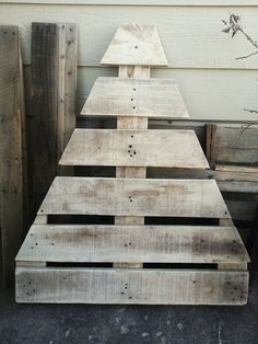 Pallet Christmas tree . Just cut it down and sand then decorate as you wish. Pretty simple.