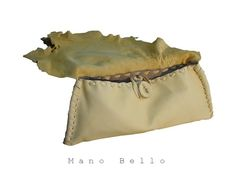 Soft raw edge deerskin leather clutch bag obsession, from Mano Bello Raw Collection in chamois yellow. Supple deerskin clutch bag is lined with Italian suede in tan, making it more substantial in weight and feel. Three inside slide pockets. Entirely hand stitched.  Approx 16 (40.64cm) in length, 6.5 (16.51cm) in height. Ready to be shipped worldwide. Sale priced. Last photo shows one in black deerskin (SOLD).  Shop more Mano Bello here: ManoBello.etsy.com and www.ManoBello.com .  Designer…