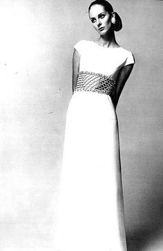 Suzy Smith in Givenchy's long column of white silk crèpe with pearl embroidered midriff, photo by Tony Kent, Paris Vogue, March 1968