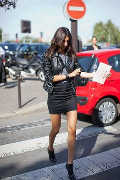 Geraldine Saglio   Street Style   Appearing at ease and comfortable in short, fitted   black skirt, gray tee and black leather jacket. Still managing a tomboy flavor to the outfit.