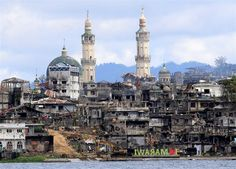 "A sign reads ""I love Marawi"" in front of the war-torn city fighting ISIS, in the southern Philippines. (Romeo Ranoco / Reuters) http://pow.photos/2017/international-pow-24-30-october/"