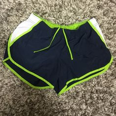 Athletic Shorts Navy blue and lime green athletic shorts! Like new, only worn about 3 times. Just don't fit me. They have a black inner liner. Size M. Accepting reasonable offers. Xersion Shorts