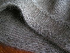 Non-roll stocking stitch edge. Yes! and other  lovely blog posts.